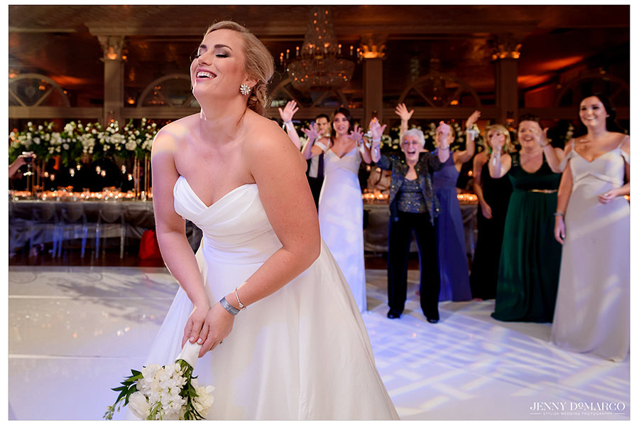 the bride throwing her bouquet to the guests