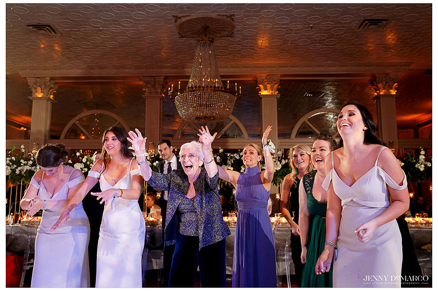 the bridesmaids cheer on the bride