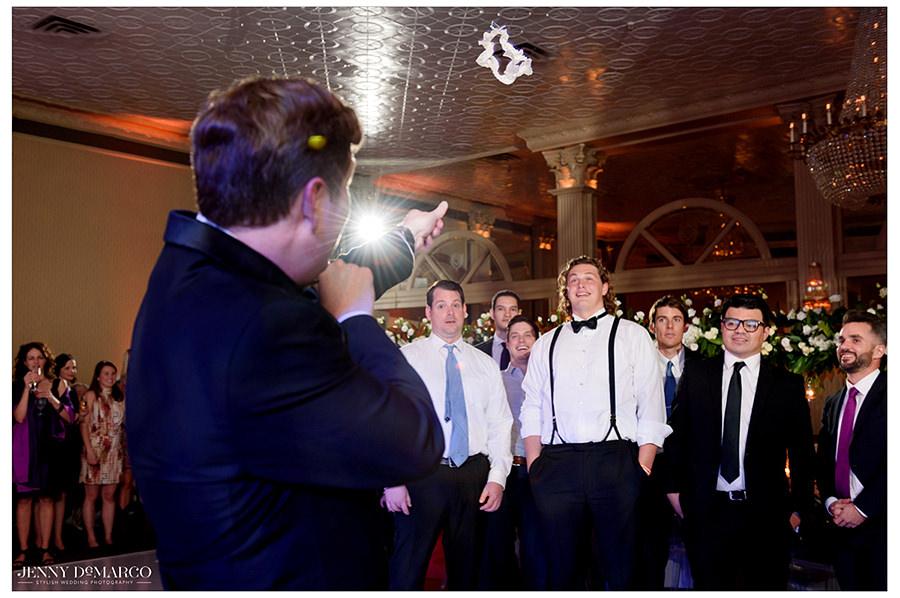 the groom slingshotting the garter