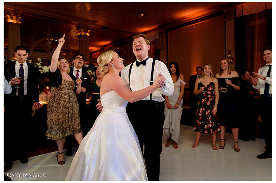 the bride laughing at her beautiful husband