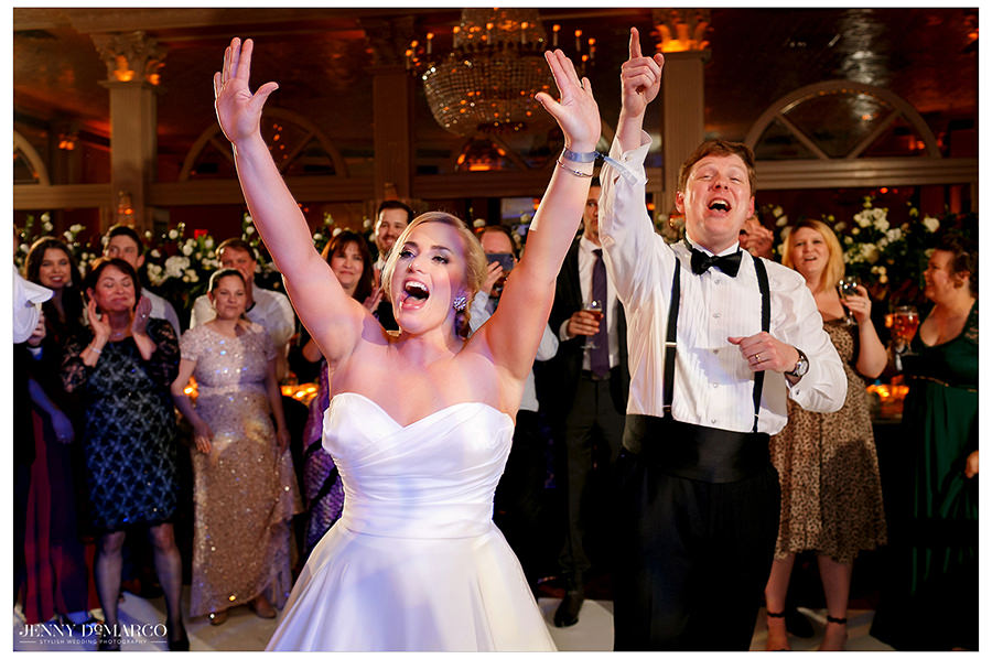 the newlyweds cheering at The Austin Club