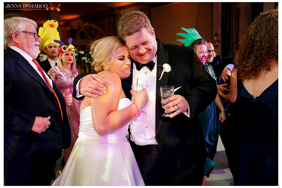 a sweet moment between the bride and groomsmen