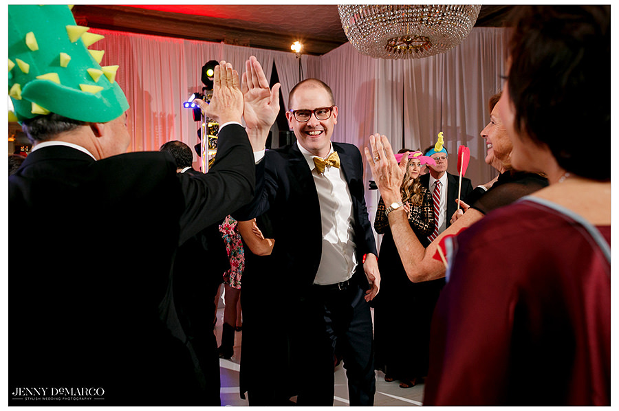 high fives between the guests