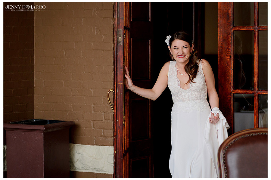 the bride exists the Driskill hotel in her first look