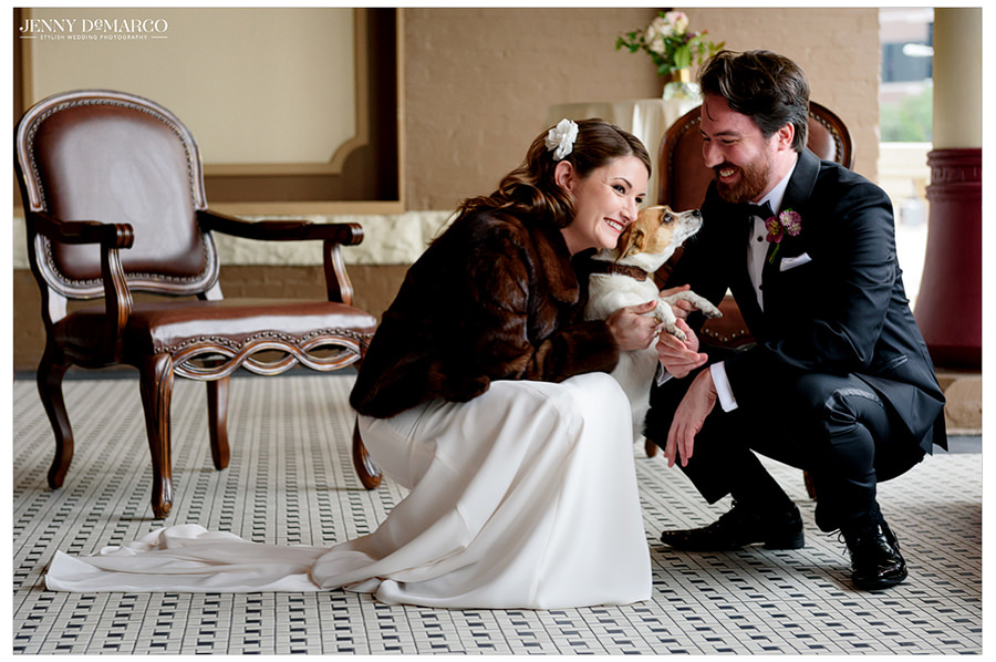 the couple hugs their puppy in the first look session