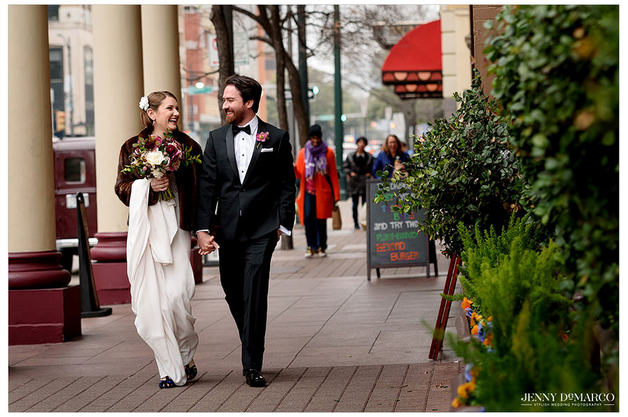 the couple walks downtown in their pre wedding shoot