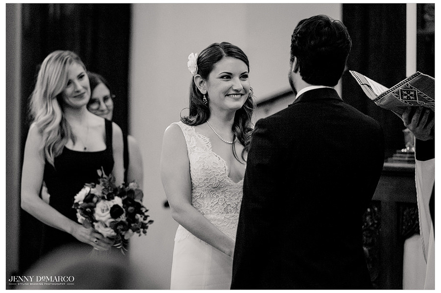 the bride smiles in the elegant black and white shot
