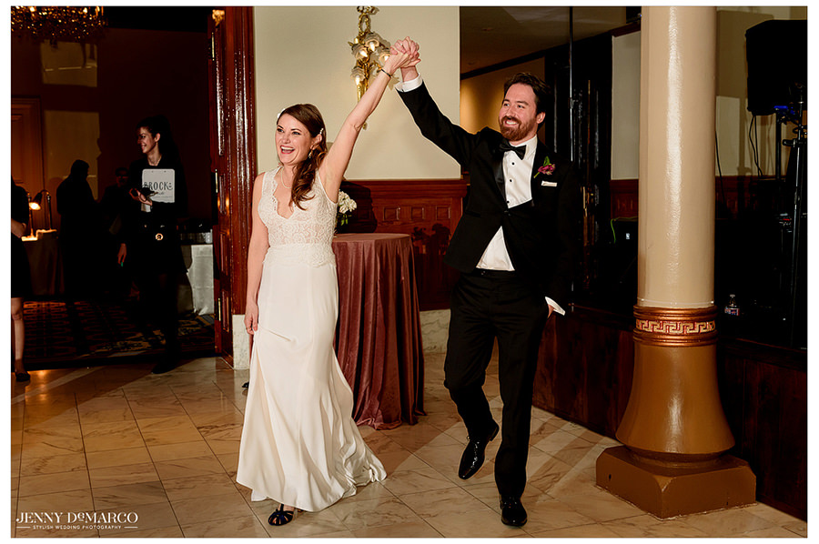 the couple makes an entrance into their reception at the Driskill hotel