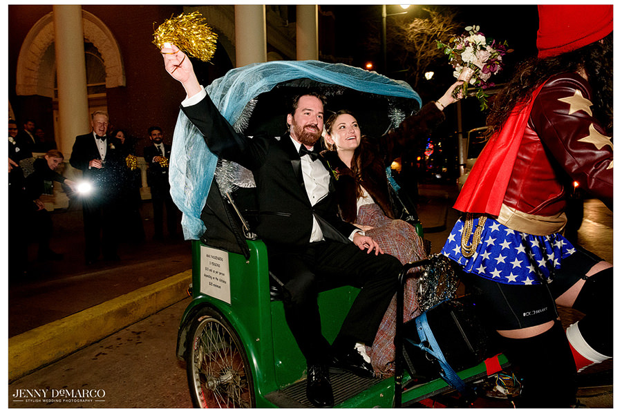 the couple rides away on their pedicab from the wedding at the Driskill hotel