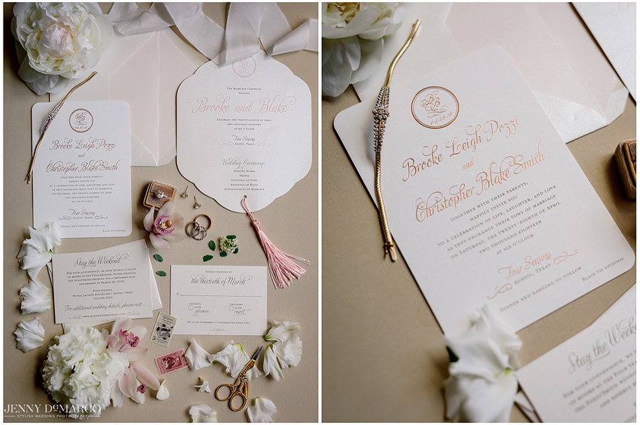 Bright and elegant wedding invitations garnished with white roses.
