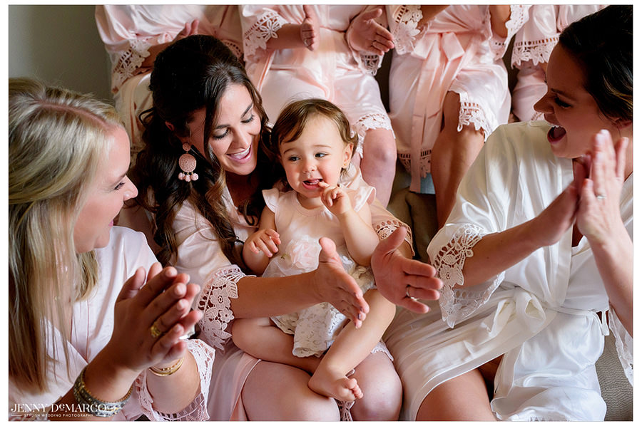 Brooke and her bridesmaids help prep the adorable flower girl.