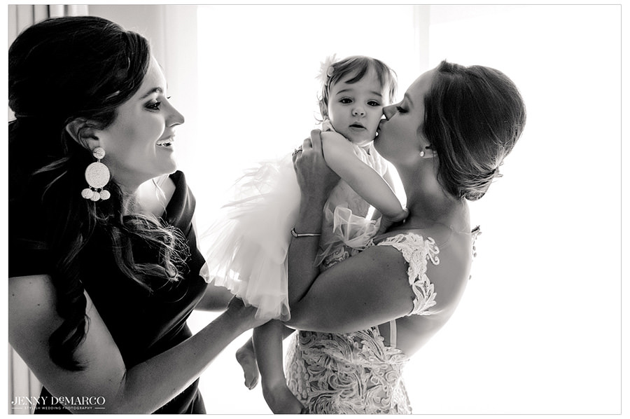 An endearing kiss given to the flower girl by the bride..