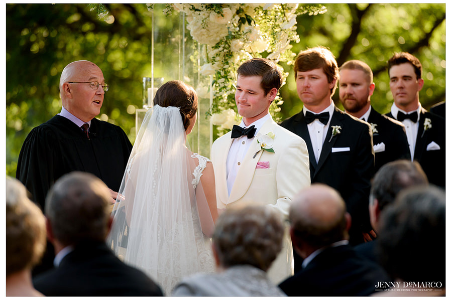 Blake looks at Brooke as they are hand in hand at the altar.