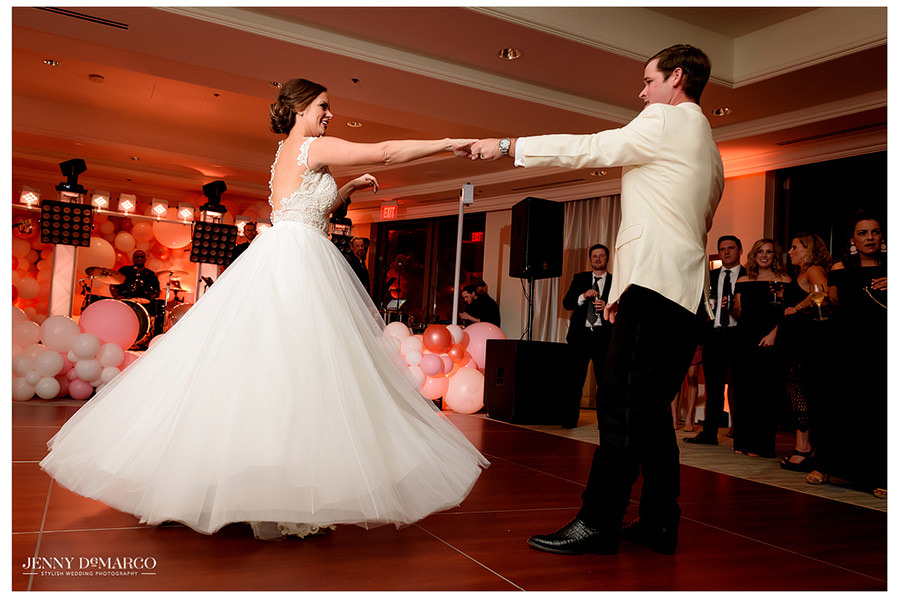Blake gives his bride a twirl as they dance together.
