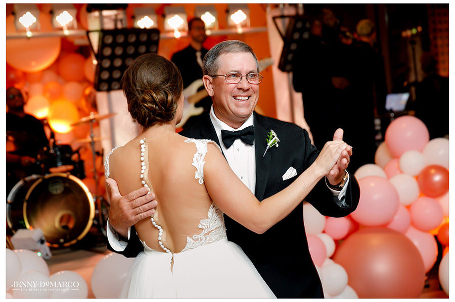 The bride dances with her father in the father-daughter dance.
