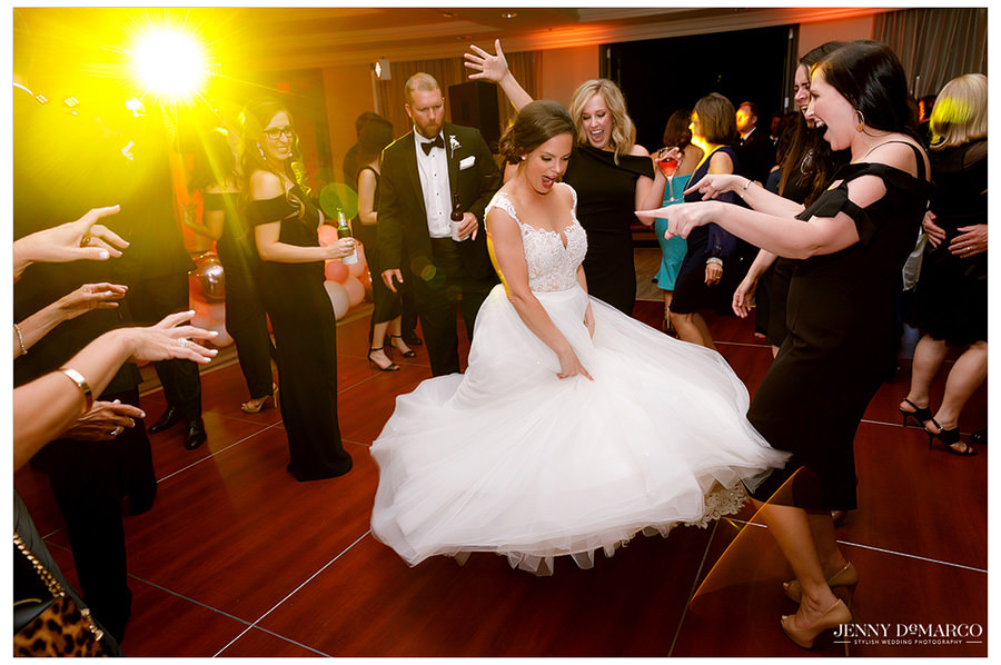 The bride shows off the tool on her dress as she dances in circles.
