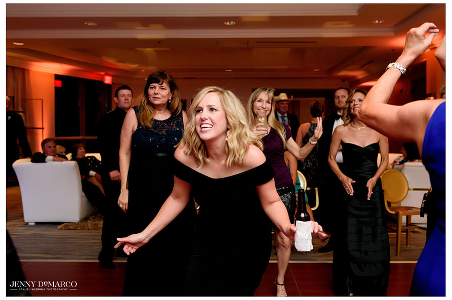 Wedding guests show off their best dance moves during the reception.