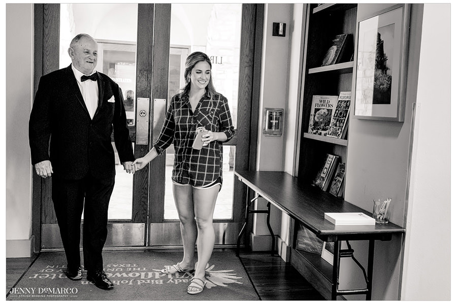 Lauren and her grandpa walking into the Wildflower Center before the wedding.