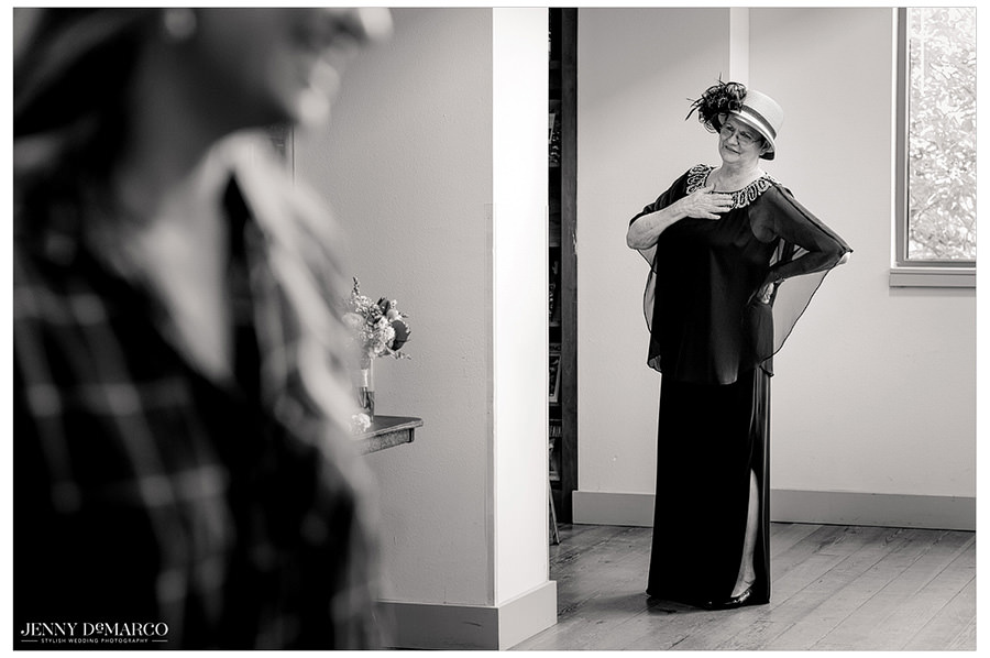 A wedding guest admiring the beautiful bride before the ceremony.