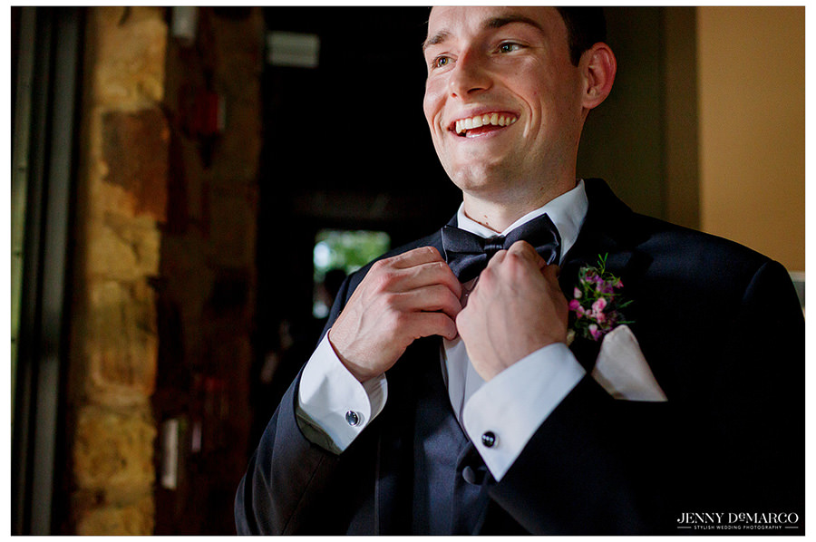Groom puts on his finishing touches before he walks down the aisle.