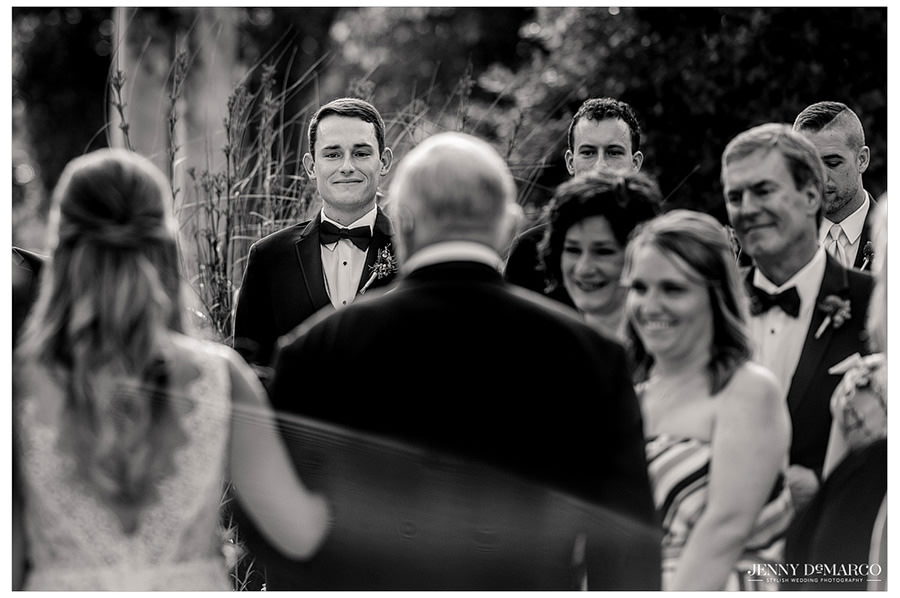Ryan gives a very endearing soft smile as he sees his bride for the first time.
