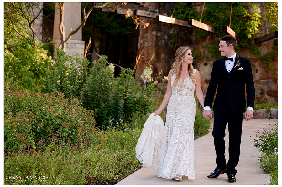 Bride and groom walk through the beautiful landscape at the Wildflower Center.