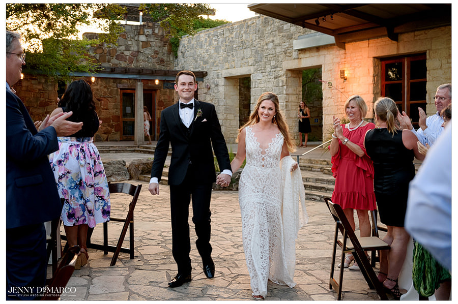 Bride and groom make their entrance into the wedding reception.