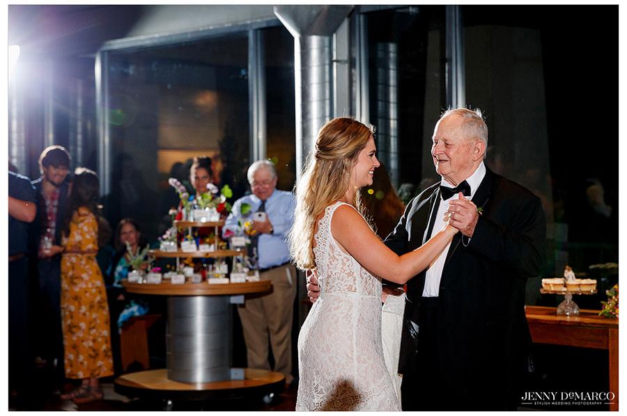 Lauren shares a sweet dance with her grandpa on the dance floor.