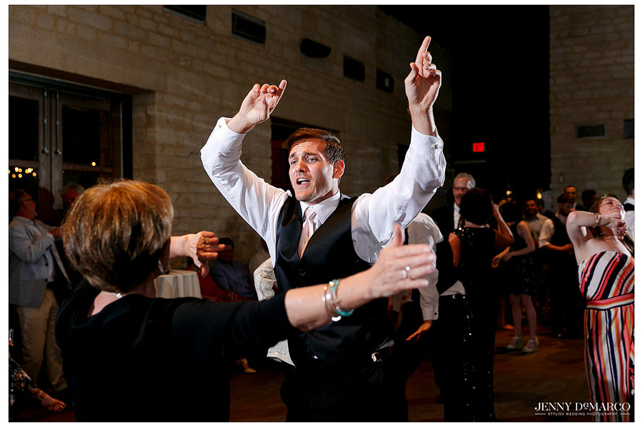 Guests sing along to the music while dancing.