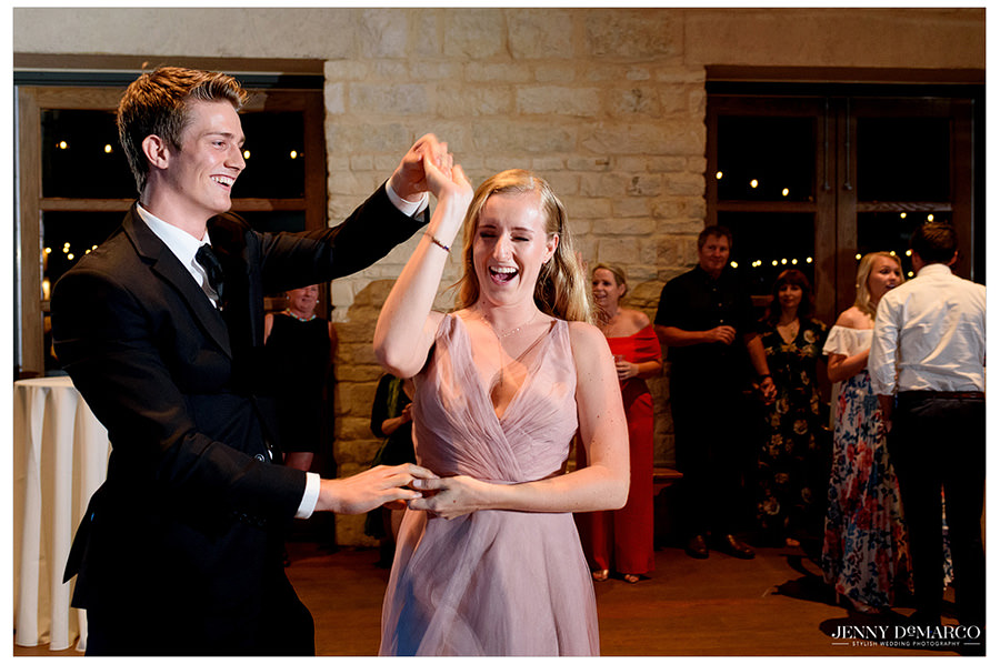 A couple dances together while other guests watch.