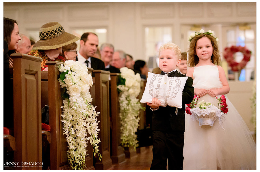 Flower girl and ring bearer complete their duties as they walk down the aisle to start the ceremony.