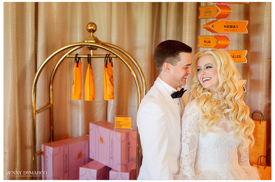 The couple shares a romantic look as they stand in-front of their reception decor.