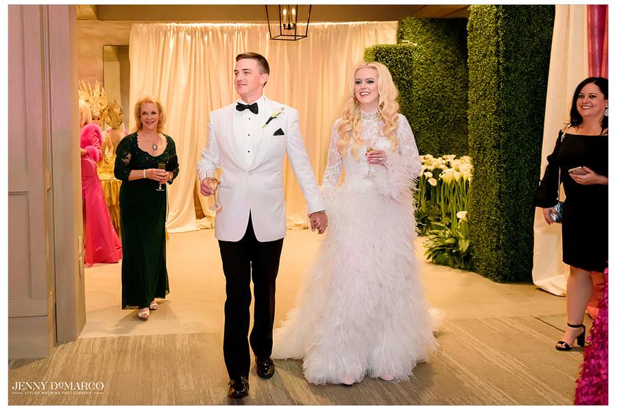 Guests excitedly welcome the newlyweds to the reception area.