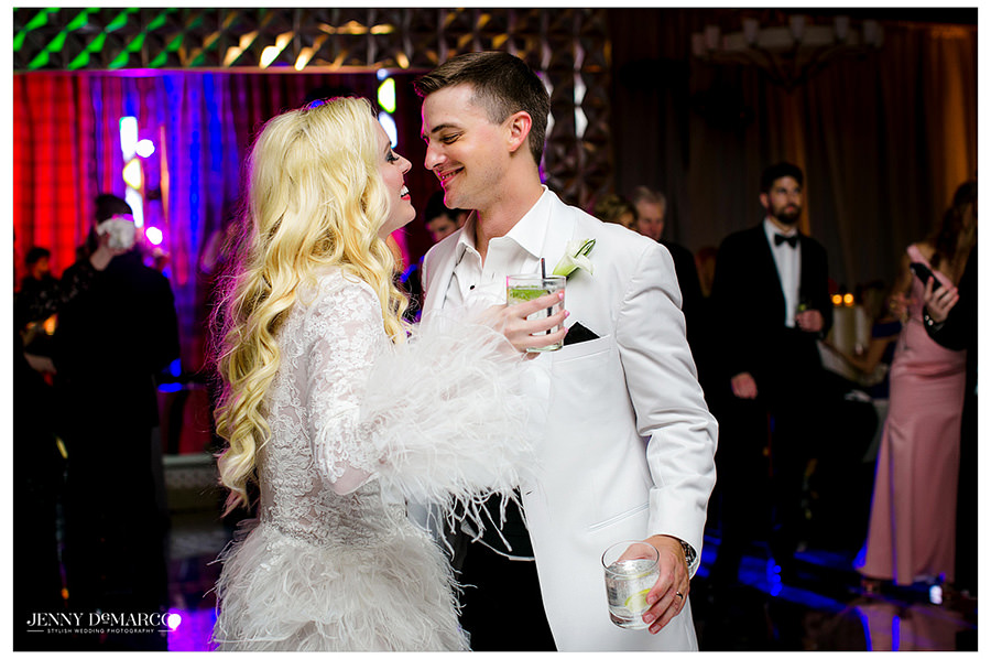 Sheridan and Tyler share an intimate look as they dance on the dance floor.
