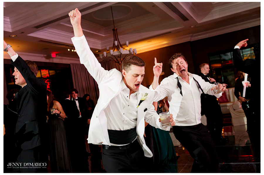 The groom breaks out his best dance moves with some of his groomsmen.