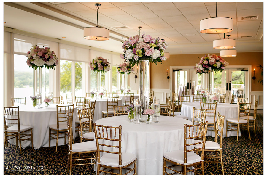 A wide angle shot of the wedding reception's pink toned decor.