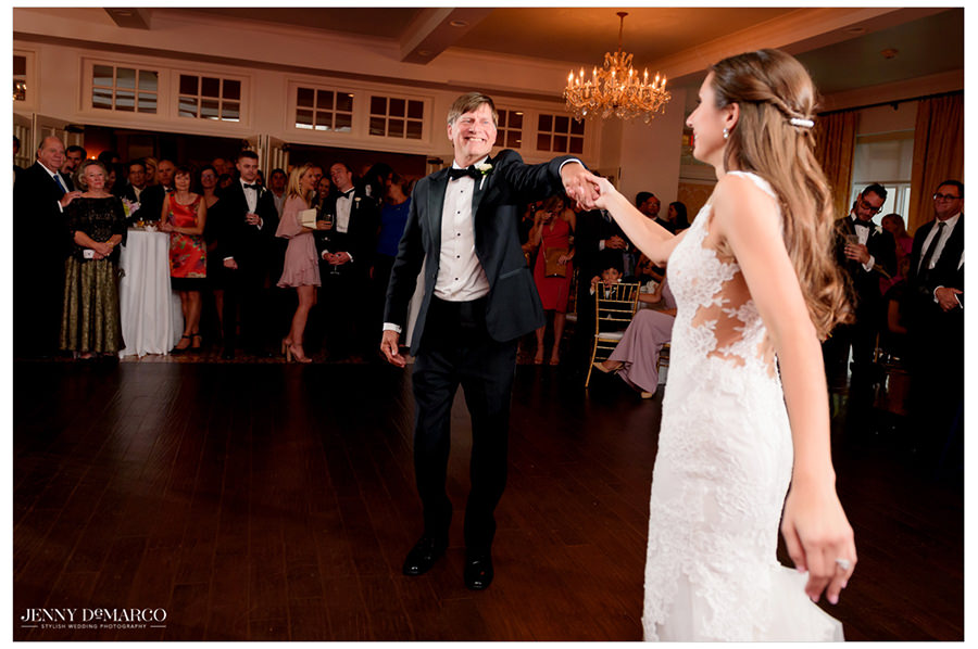 Father of the bride shares a dance with his newly-wedded daughter.