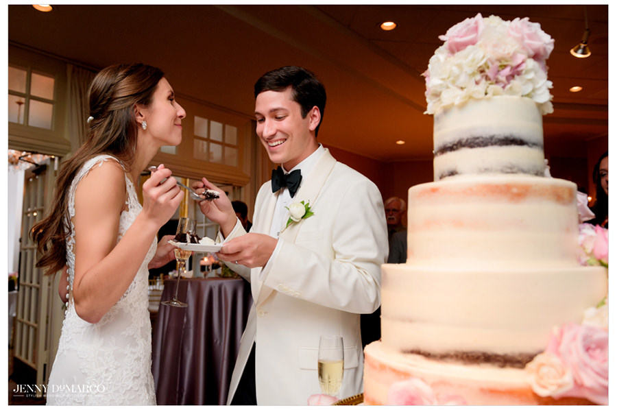 The couple shares a taste of their wedding cake.