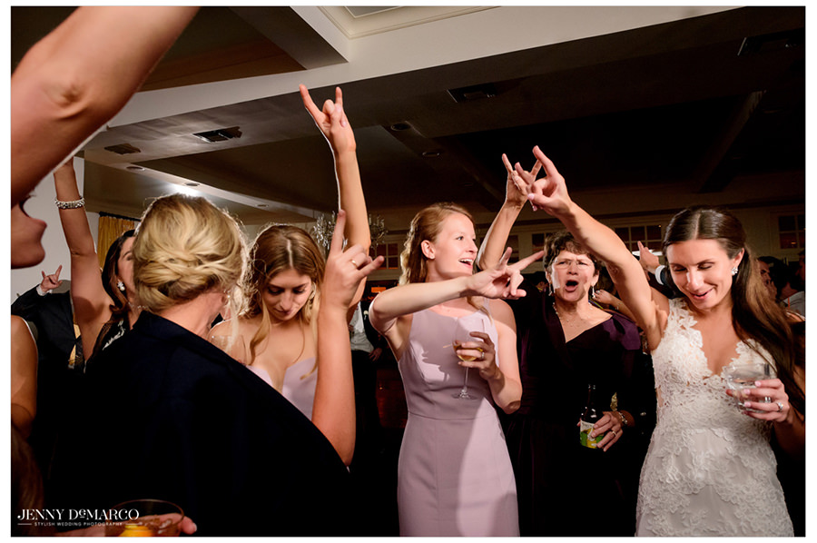 "The bride and all of her UT friends gather together to sing ""Texas Fight."""