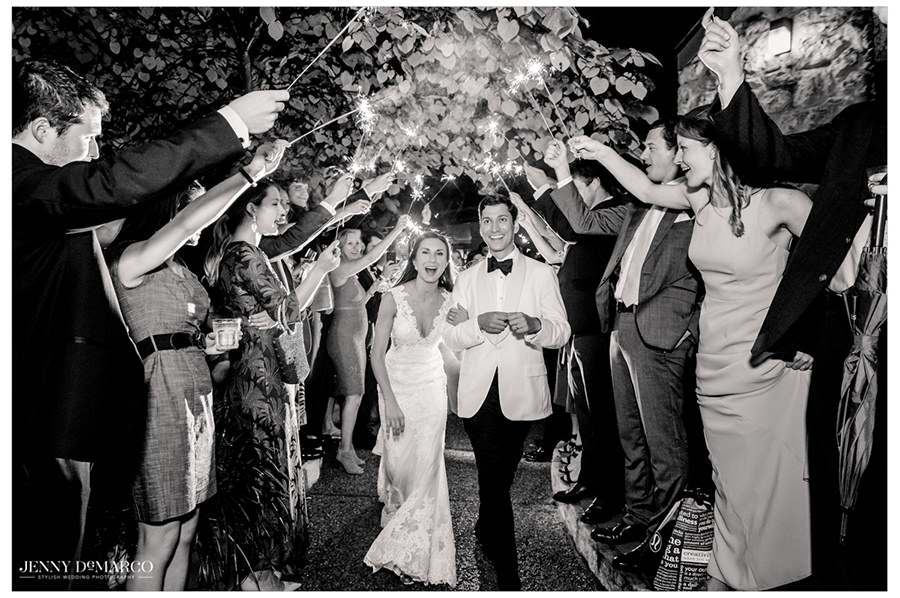 The couple ends the night walking under a tunnel of sparklers that are held by their guests.