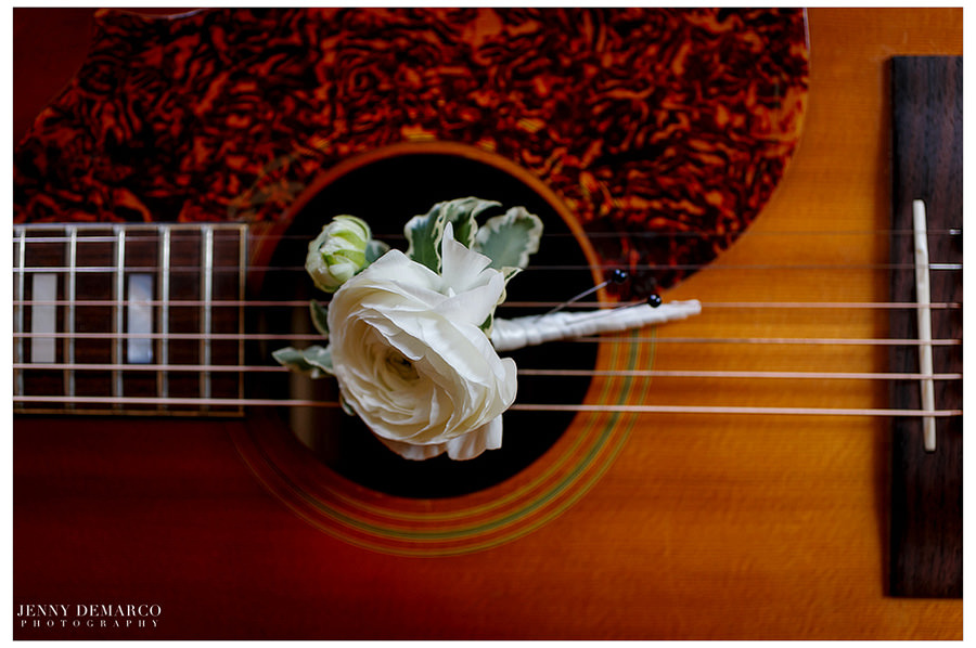 A delicate white rose rest on top pf Josh Abbott's guitar.