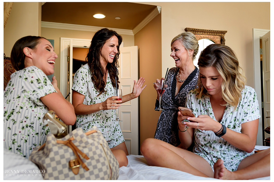 Bridesmaids gather together to relax before they put on their dresses.