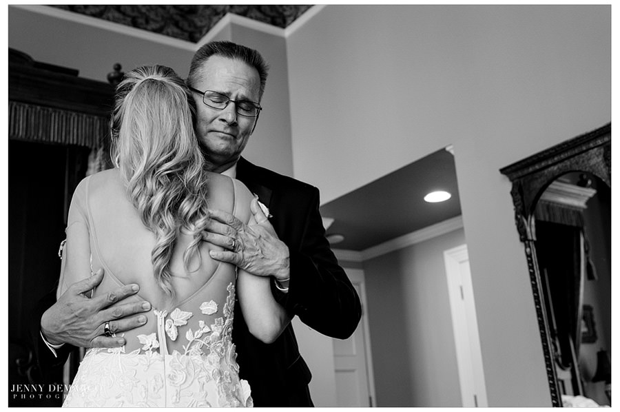 The father of the bride shares a sweet moment with his daughter before he has to give her away.