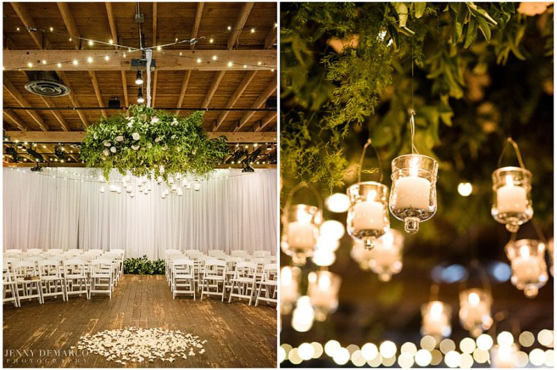 The wedding ceremony is covered with white and green florals and illuminated with hanging candles.