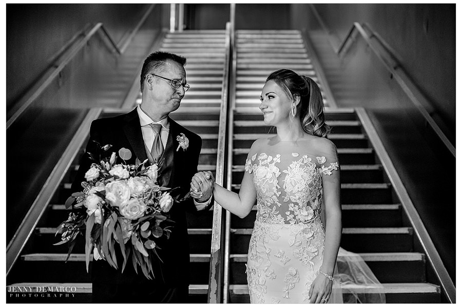 Father of the bride shares one last moment with his daughter as they walk down the stairs towards the reception.