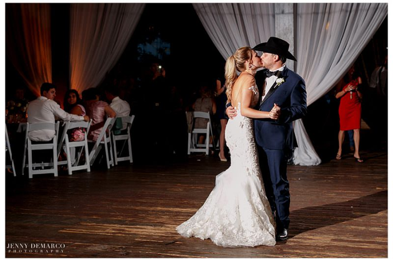 Josh kisses his bride during their first dance.