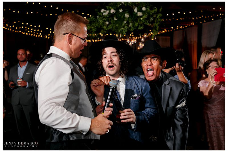 Guests join in on a microphone to sing during the reception.