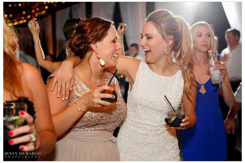 Bride gives a big hug to her sister during the dance party.