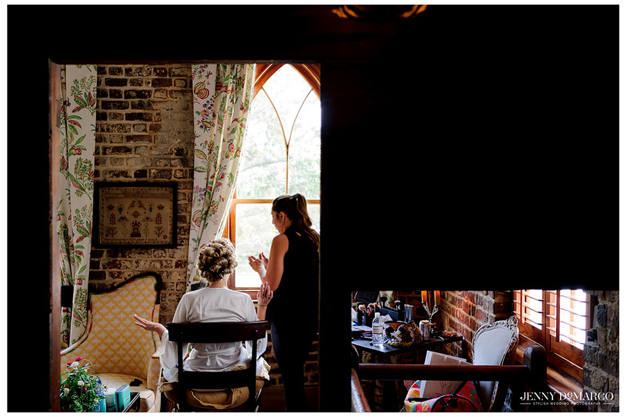 Bride, Elaine, Gets her makeup done in a very rustic home.