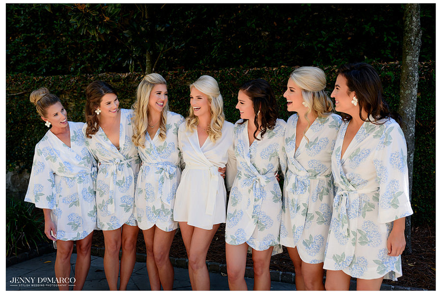 All of Elaine's bridesmaids gather for a group photo in their blue and white satin robes.